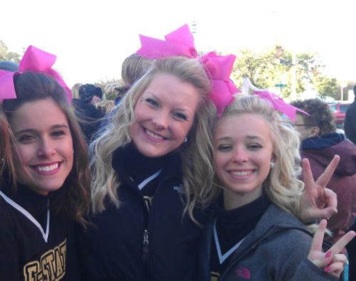 Kami Zahner in cheer uniform with friends