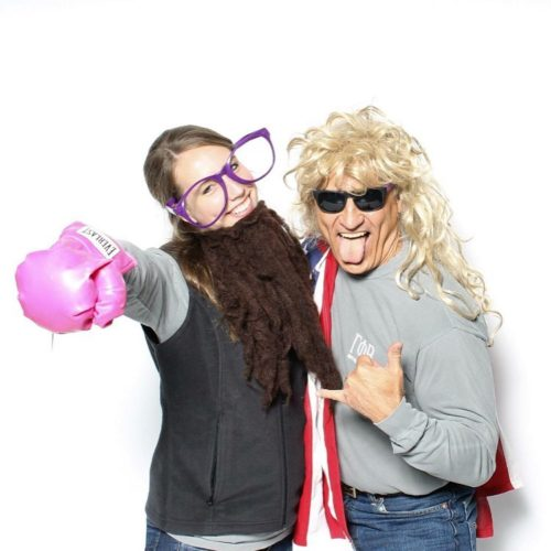 Taylor Russo and her dad in photo booth props