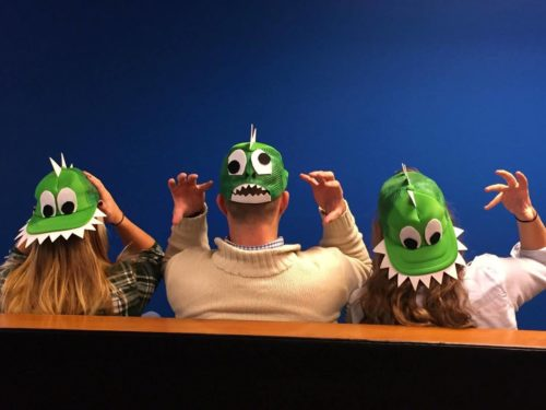 """Taylor Russo and two co workers with """"dinosaur hats"""""""
