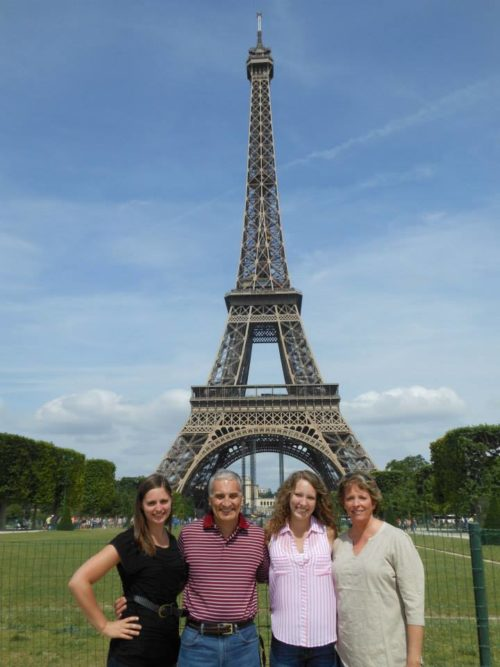 Taylor Russo and family in front of Eiffel tower