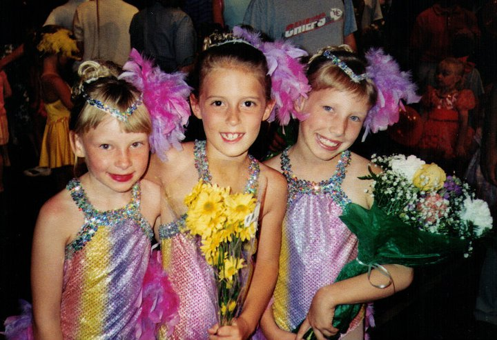 Young Taylor Russo in dance costumes with two friends
