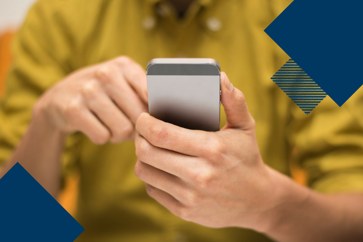 man in yellow shirt on cell phone with dark blue geometric shapes on top of overall image