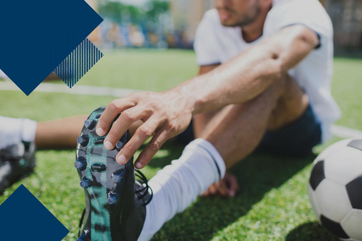 soccer player stretching leg
