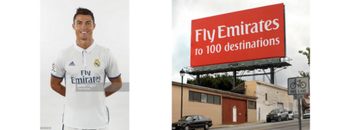 Christiano Ronaldo on the left, a Fly Emirates billboard on the right