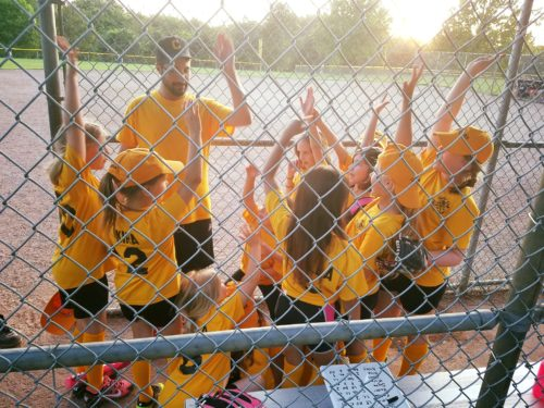 Pedro coaching his kids' teams
