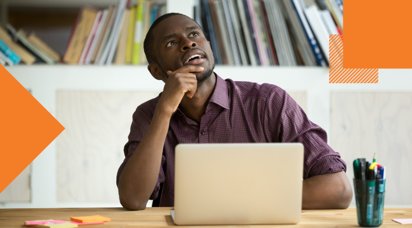 African American office worker looking away thinking of problem