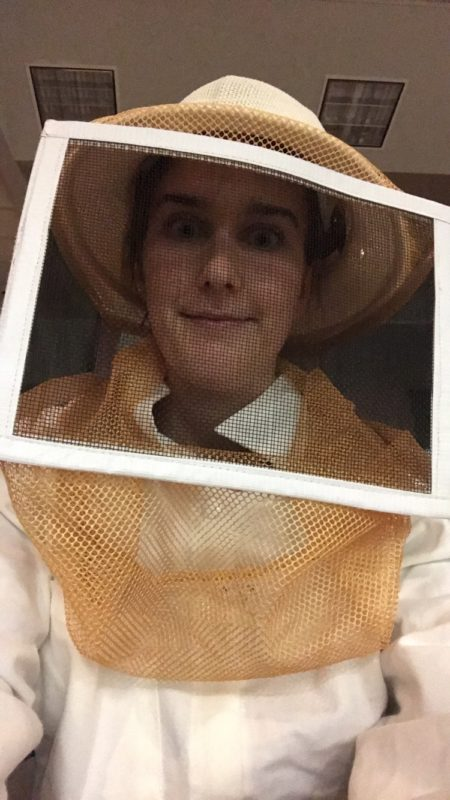 Grace in a beekeeper uniform