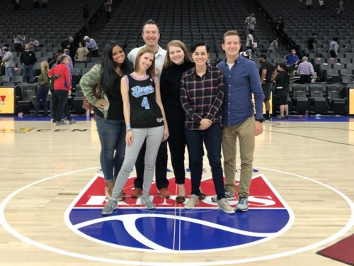 Anna with clients at a basketball game
