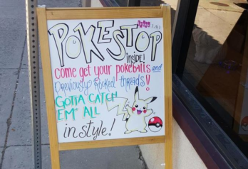 """Sign that says """"Poke Stop inside! come get your pokeballs and previously rocked threads! Gotta catch em all in style!"""""""